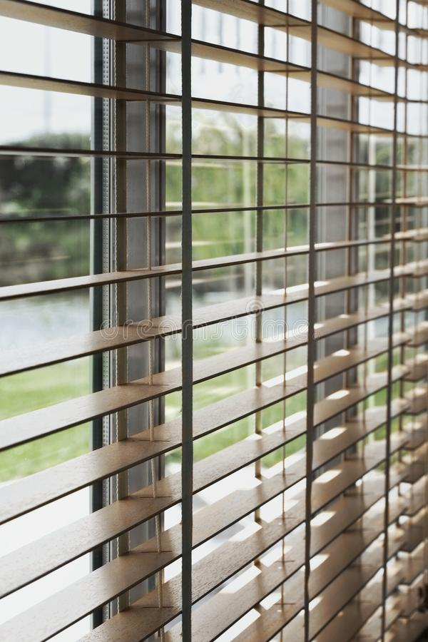 Blind on a window. Close up of a venetian blind inside home during Summer stock photography