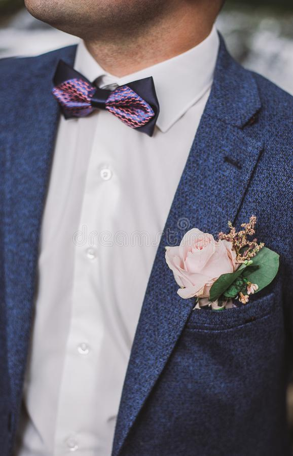Close-up vertical color image of handsome groom stock photography
