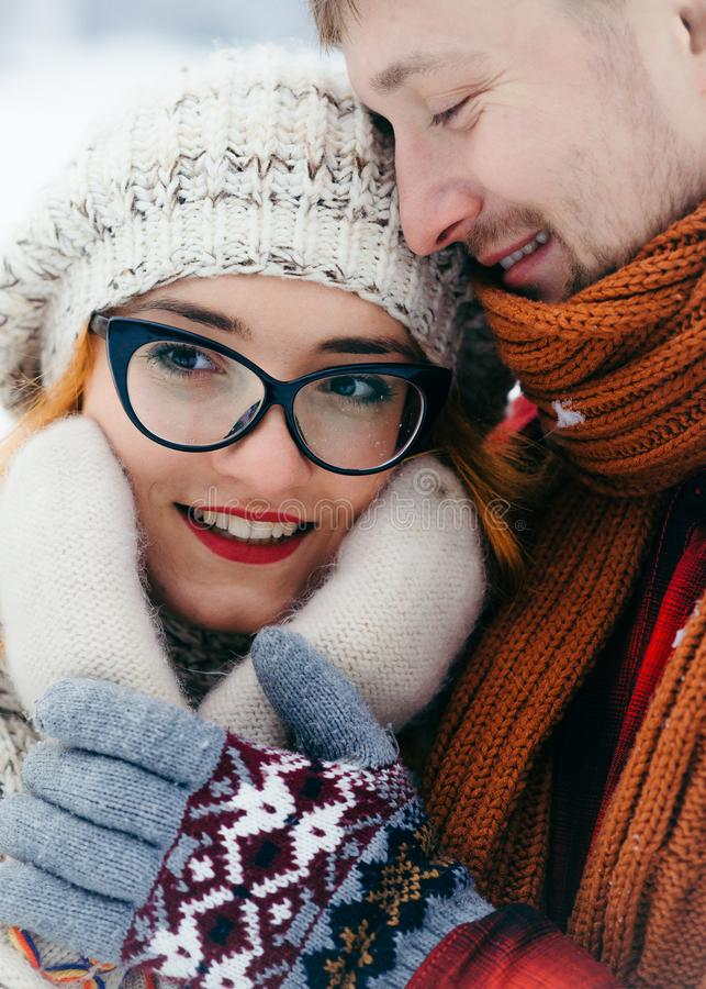 Close Up Vertical Portrait Loving Happy Couple Hugging Touching Hands Winter Outdoor Beautiful Smiling. royalty free stock photo