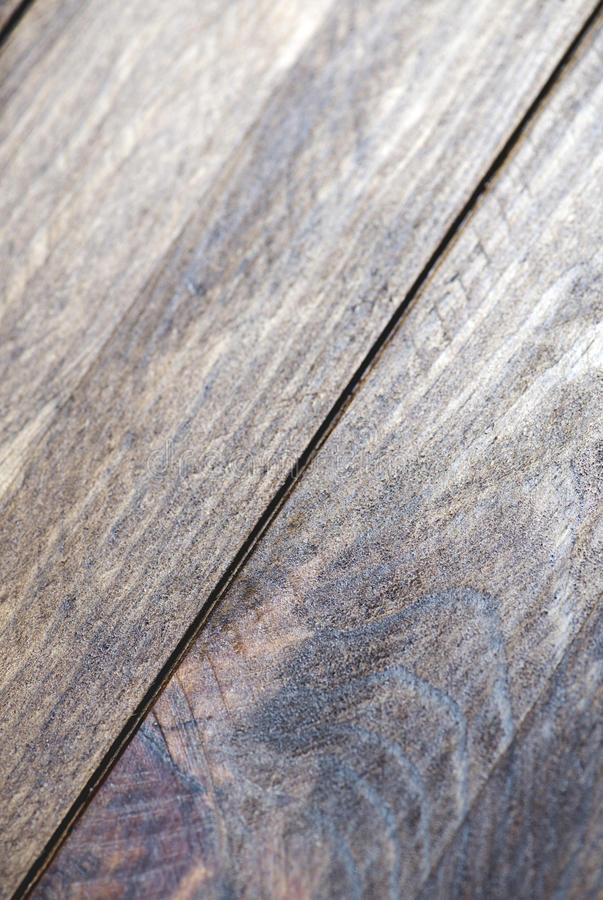 Close-up vertical shot of dark brown wooden table. Texture stock image