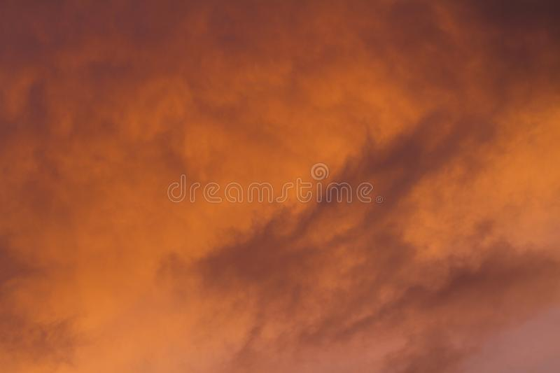 Close up of vibrant clouds during a summer sunset. With an intense color stock image