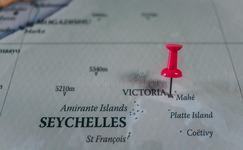 Close up of Victoria pin pointed on the world map with a pink pushpin royalty free stock photography