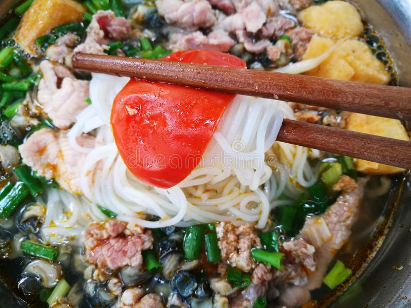 Close up of Vietnamese snail noodle soup Bun Oc royalty free stock image
