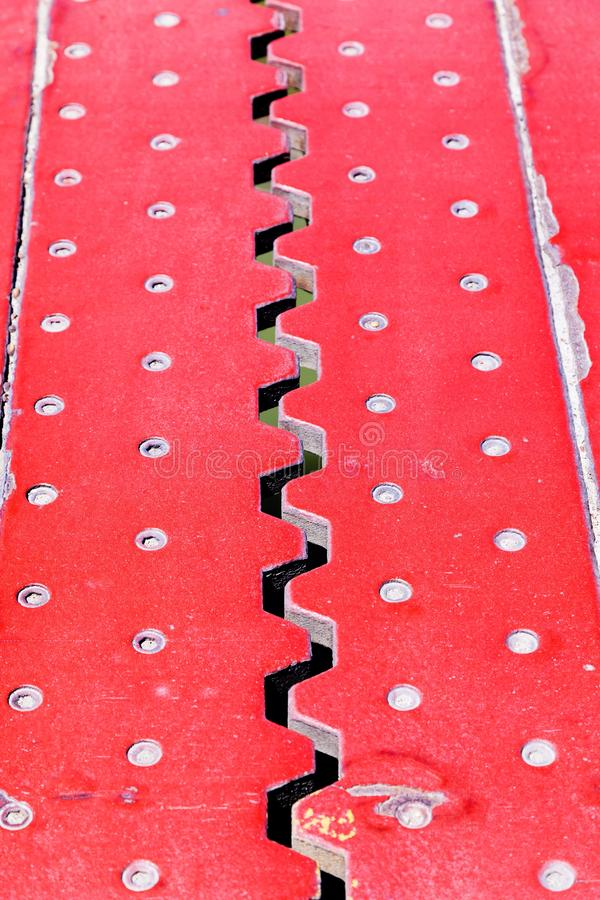 Close up view from above of an red iron dilatation joint placed. Top view from above of an red iron dilatation joint placed on a opening bridge road - Zigzag stock images