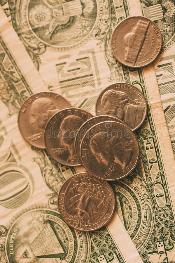Close up view of American dollar bills and coins as background. Heap of American dollars for design. Financial and economic concept royalty free stock image
