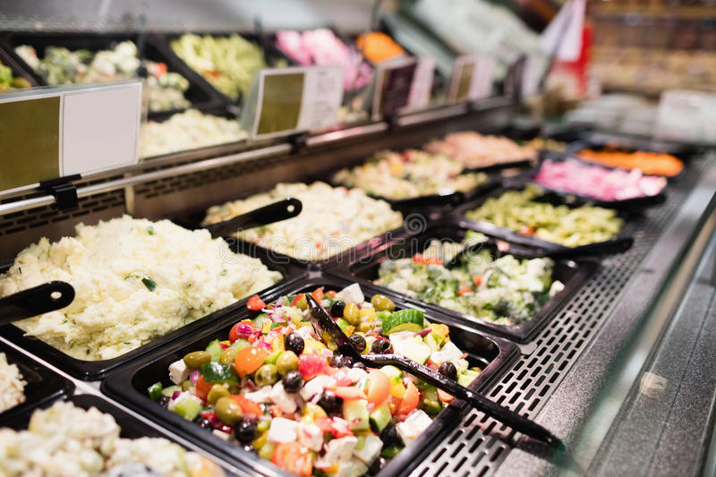 Close up view of an appetizing buffet of prepared meal. In grocery store stock photos