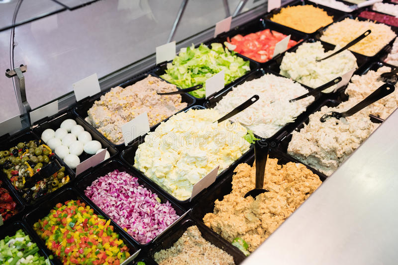 Close up view of an appetizing buffet of prepared meal. In grocery store stock photo