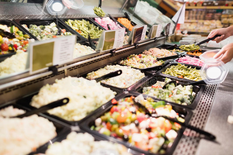 Close up view of an appetizing buffet of prepared meal. In grocery store royalty free stock photos