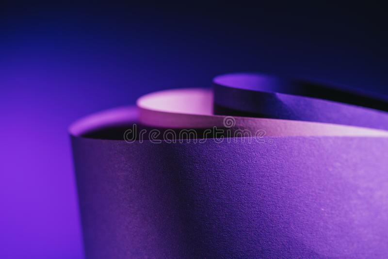 Close up view of arcs of purple and pink paper stock images