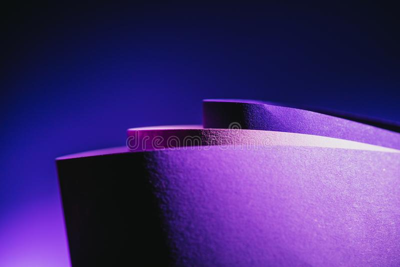 Close up view of arcs of purple and pink paper stock photos
