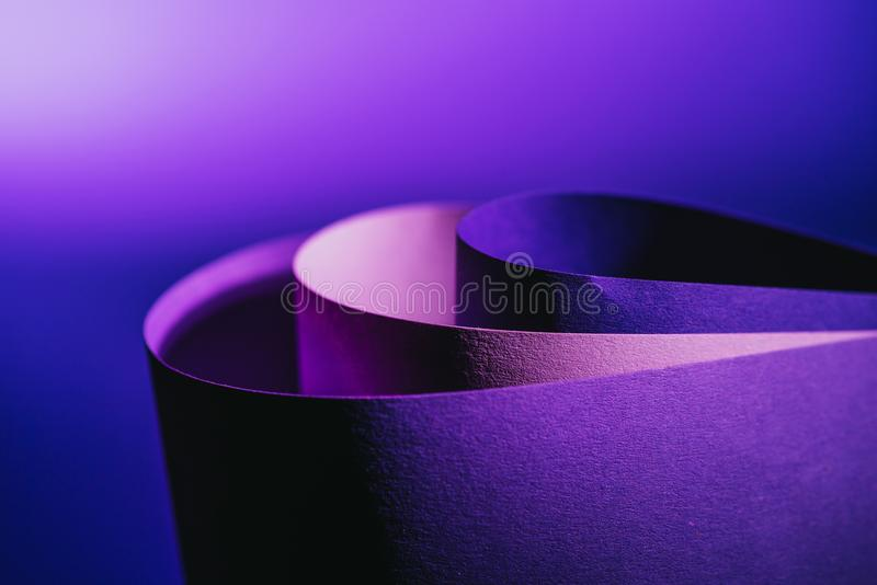 Close up view of arcs of purple and pink paper stock image