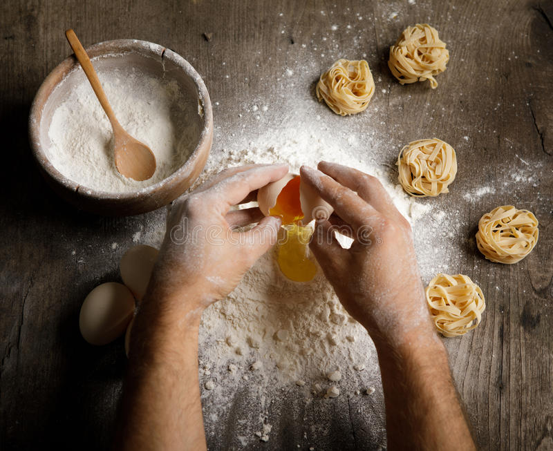 Close up view of baker kneading dough. Homemade bread. Hands preparing bread dough on wooden table. Preparing traditional royalty free stock image
