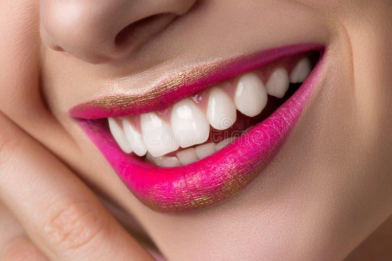 Close up view of beautiful smiling woman lips stock photo