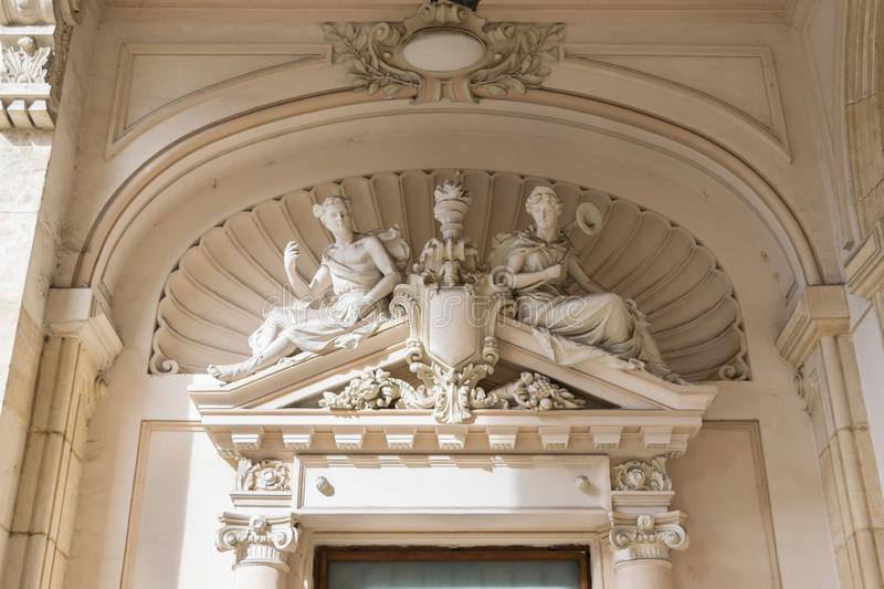 Close up view of a beautiful stone sculpture on the facade of the building entrance.  stock images