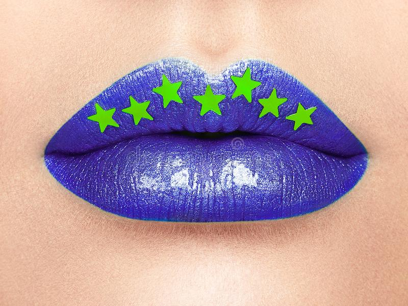 Close up view of beautiful woman lips with purple lipstick. Cosmetology, drugstore or Fashion Makeup Concept Gold stars. Beauty studio shot. Passionate Kiss stock photos