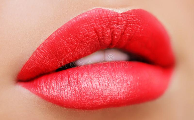Close up view of beautiful woman lips with purple matt lipstick. Open mouth with white teeth. Cosmetology, drugstore or fashion. Makeup concept. Beauty studio stock image