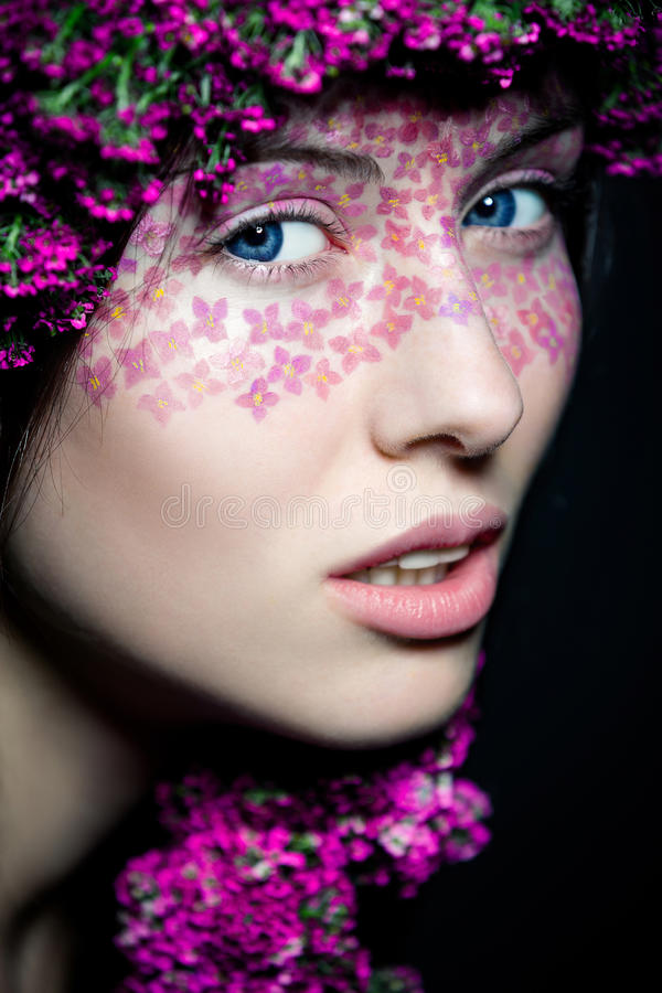 Download Close Up View Of Blue-eyed Girl With Flowers Royalty Free Stock Image - Image: 28494816