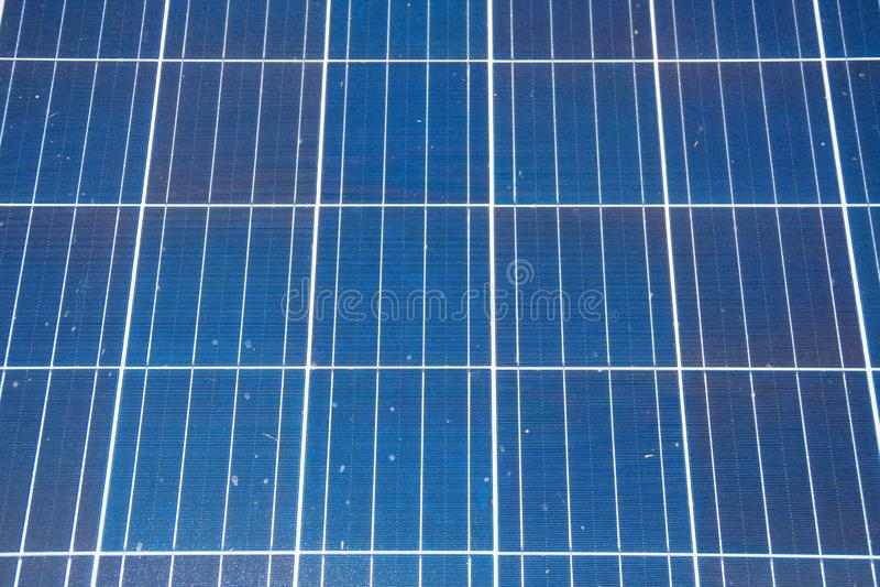 Blue solar panels. Close-up view of blue solar panels. Renewable energy stock photos