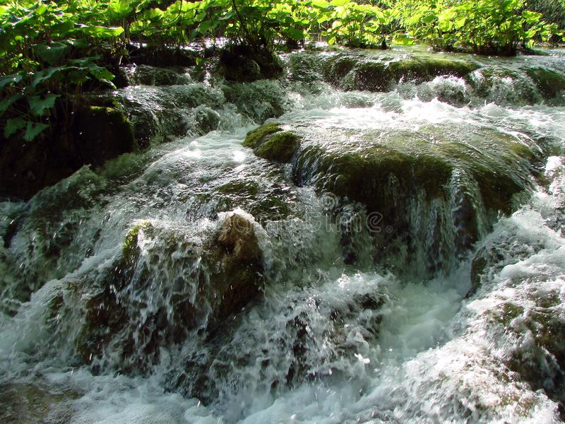 Fantastic panorama and natural scenery of forests, mountain rivers and waterfalls near Plitvice Lakes in Croatia. Close up view of boiling foam and numerous stock photography