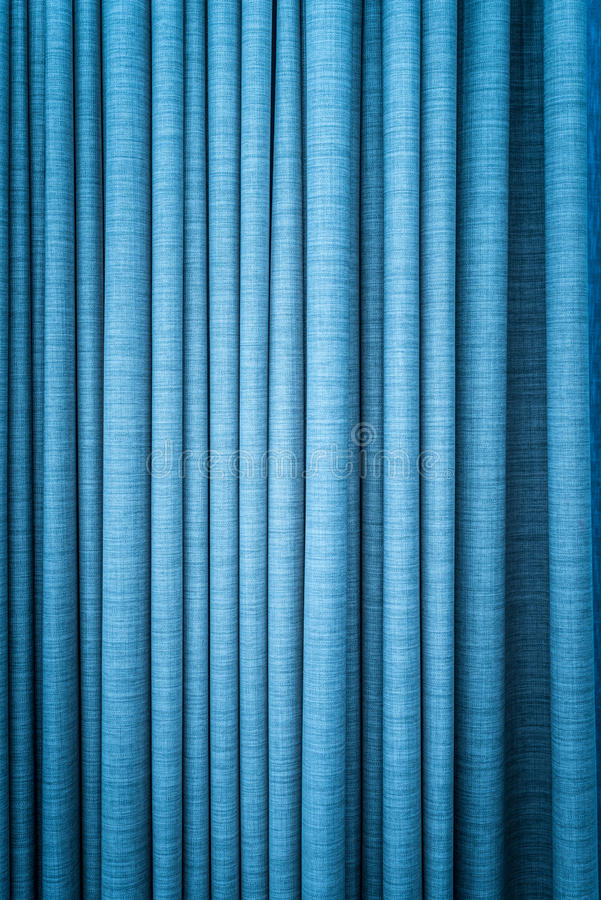 Download Blue Curtain In Folds Textured Background Stock Photo