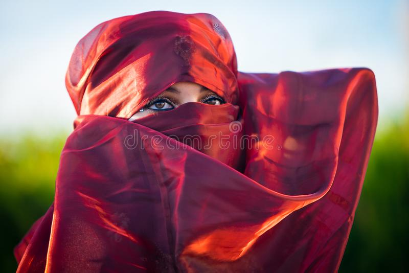 Close up view of brown woman eyes framed by headscarf royalty free stock photo