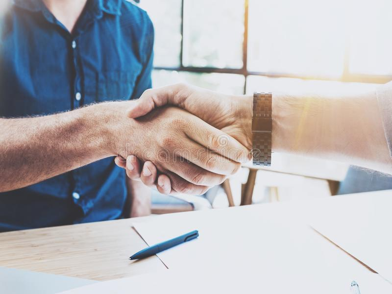 Close up view of business partnership handshake concept.Photo two businessman handshaking process.Successful deal after. Great meeting.Horizontal, blurred stock photography