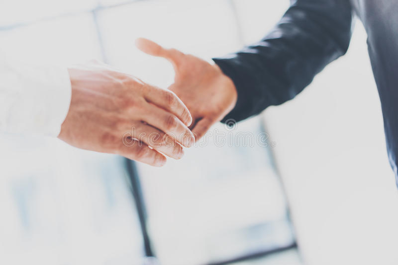 Close up view of business partnership handshake concept.Photo two businessman handshaking process.Successful deal after. Great meeting.Horizontal, blurred stock image