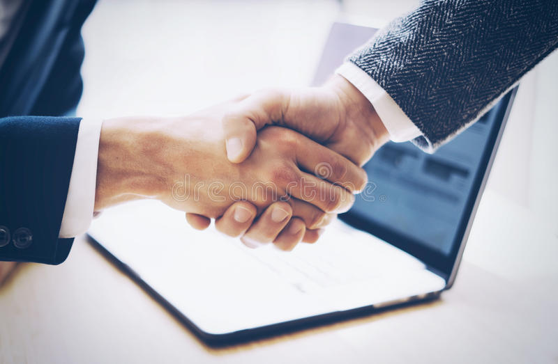 Close up view of business partnership handshake concept.Photo two businessman handshaking process.Successful deal after. Great meeting.Horizontal, blurred royalty free stock photos