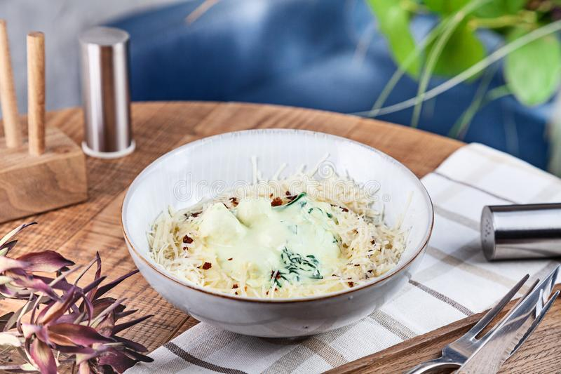 Close up view on Chicken Meatballs in cream sauce with cheese parmesan in bowl. Healthy, dieting, balanced food for lunch. Wooden royalty free stock photos