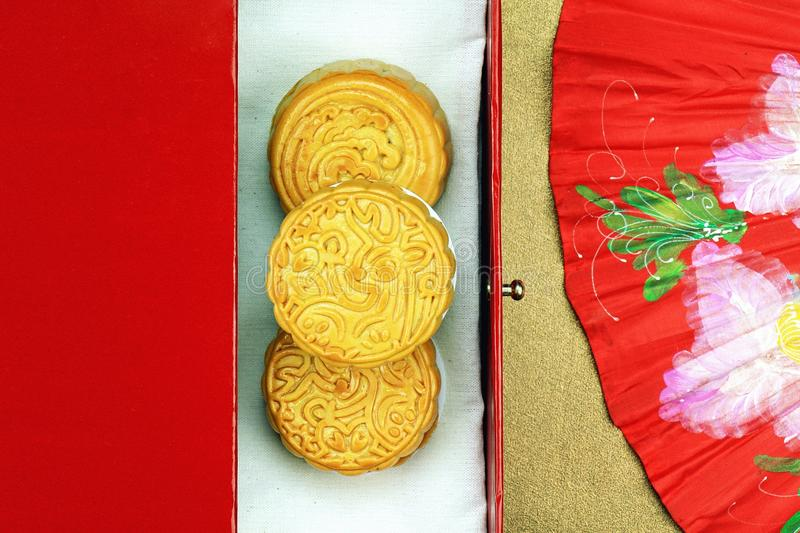 Close up view of Chinese moon cake and red oriental chinese fan for celebrate in Mid autumn festival stock photography