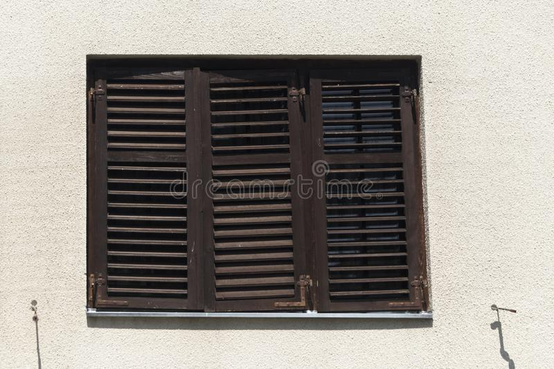 Close up view of closed window with wooden shutters. Outdoor stock images