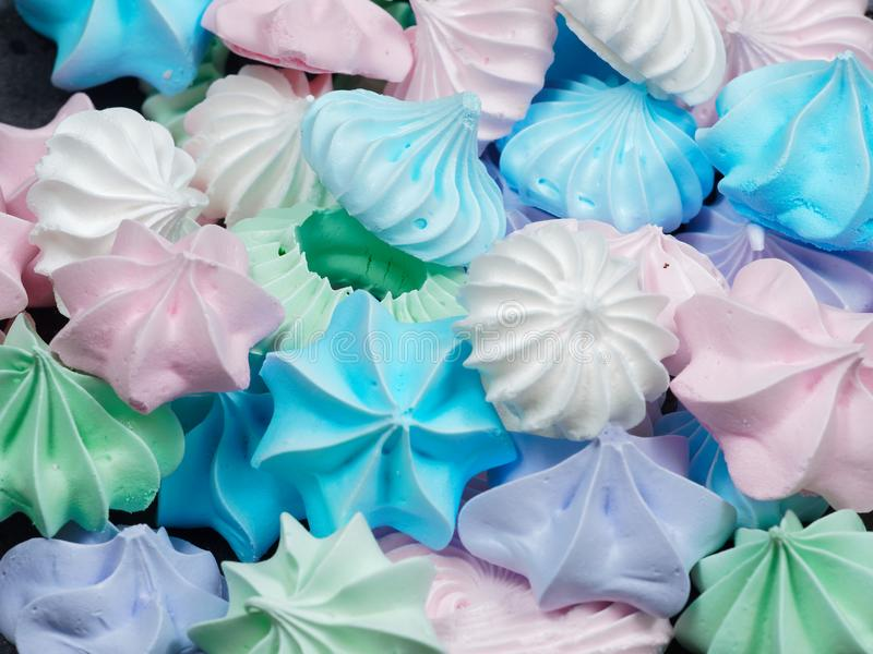 Colorful meringue cookies. Close-up view of colorful mini meringue cookies stock photos