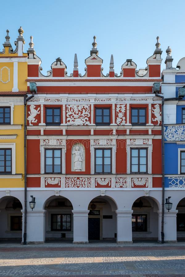 Close up view of colourful renaissance buildings in the historic Great Market Square in Zamosc in southeast Poland. stock photo