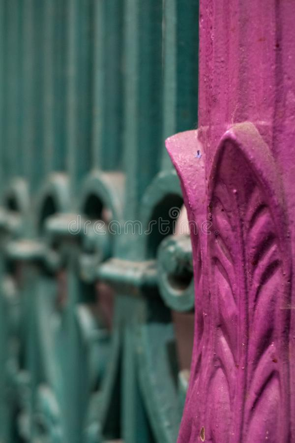 Close up view of colourful wrought ironwork at Smithfield meat and poultry market in the City of London, UK. royalty free stock photography