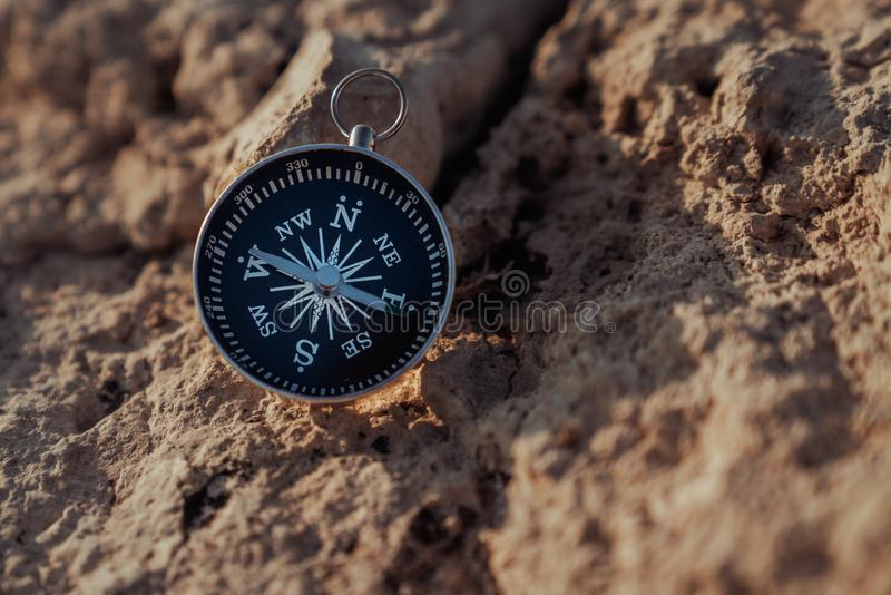 Close up view of the compass on the rock royalty free stock photo