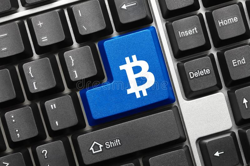 Conceptual keyboard - Blue key with Bitcoin symbol. Close-up view on conceptual keyboard - Blue key with Bitcoin symbol stock photo