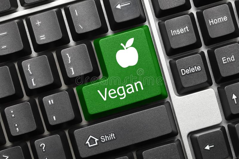 Conceptual keyboard - Vegan green key with apple symbol. Close-up view on conceptual keyboard - Vegan green key with apple symbol stock photos