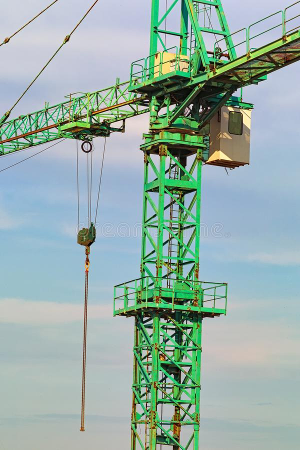 Close up view of a construction crane against blue sky. The metal element to the tower crane. Construction site. Close up view of a construction crane against royalty free stock photo