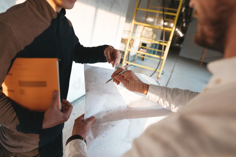 Close up view on construction drawing in engineer hands stock images