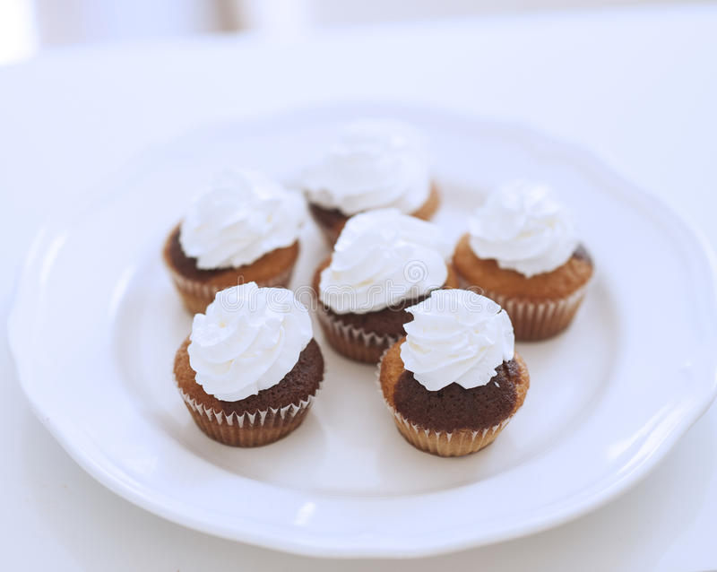 Close-up view of cup cakes on plate stock photography