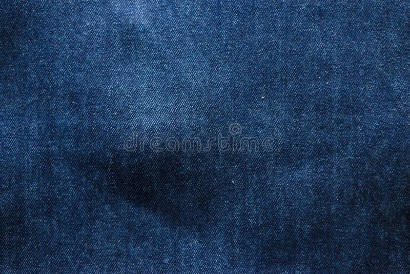 Close-up view dark blue jeans for background. denim texture royalty free stock photography