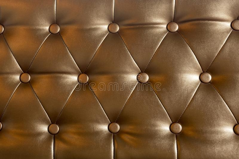 Decorated with sofa elegant buttons brown leather thong used as background. royalty free stock images