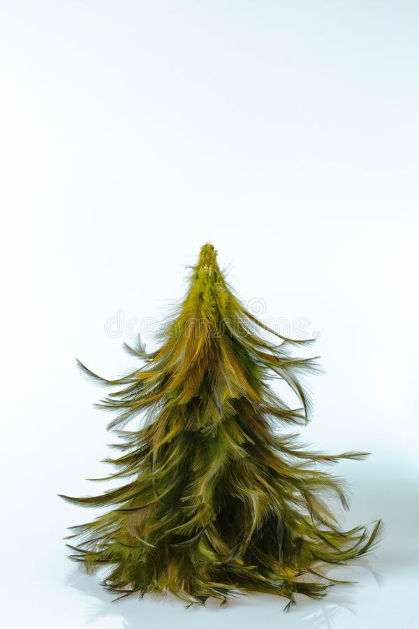 Close up view of decorative christmas tree made of rooster feathers isolated. Hobby concept.  royalty free stock image