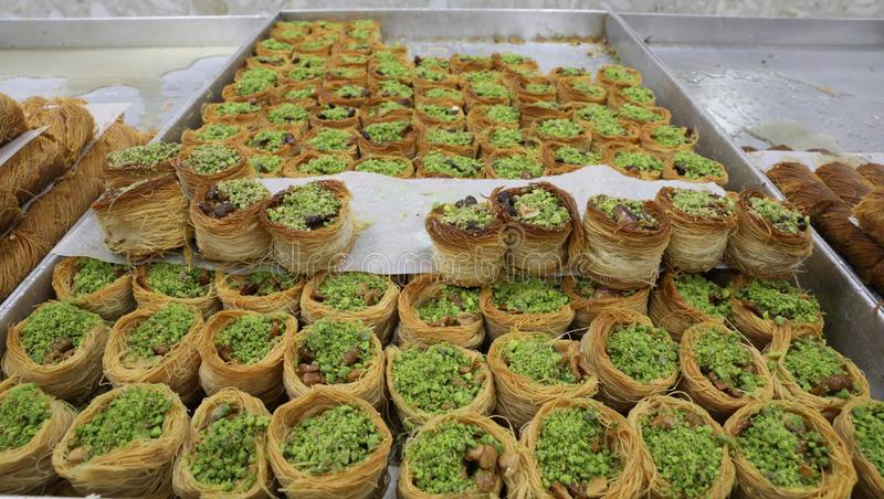Close up view of delicious Arabic kataifi/kadayif pastry nest cookies dessert with Pistachio nuts royalty free stock photography