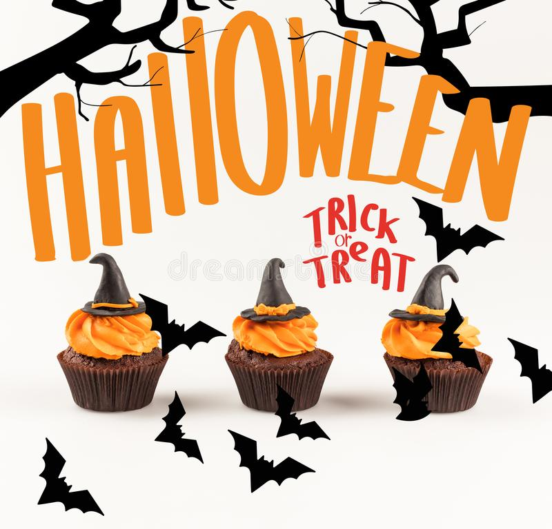 Delicious halloween cupcakes. Close-up view of delicious homemade halloween cupcakes with witch hats isolated on white stock images