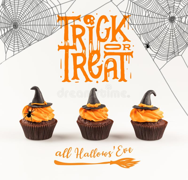Delicious halloween cupcakes. Close-up view of delicious homemade halloween cupcakes with witch hats isolated on white royalty free stock photos