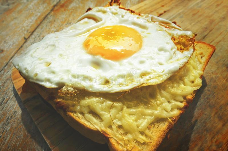 Close up view of delicious traditional French breakfast sandwich known and croque madame with toast bread and fried egg on top fil royalty free stock image