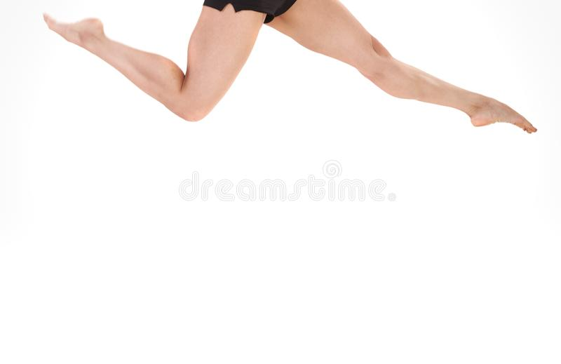 Legs of the woman jumping on a white background royalty free stock images