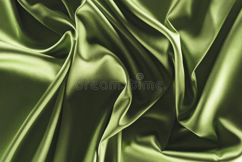 Close up view of elegant green silk cloth. As backdrop stock photos