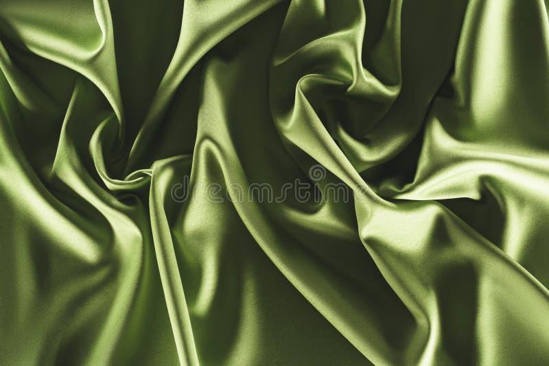 Close up view of elegant green silk cloth. As backdrop royalty free stock photos